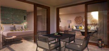 Suite del resort Lopesan Costa Bávaro en Punta Cana con una mesa para cuatro
